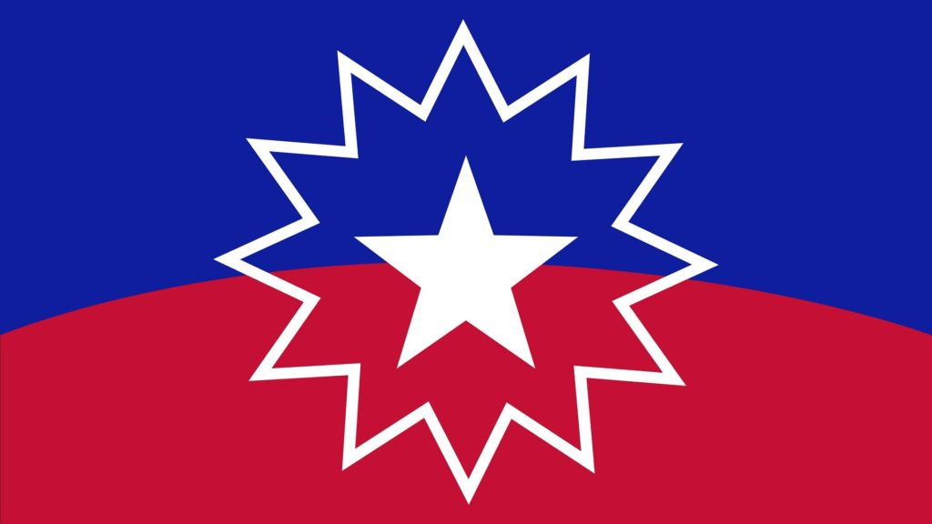 The rectangular Juneteenth flag. It is royal blue and red with a white star in the center surrounded by a a 12 pointed star outline